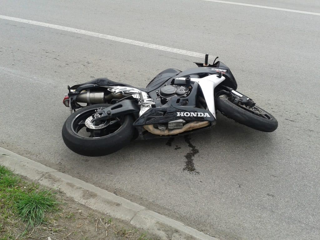 Who is responsible for paying after a motorcycle accident